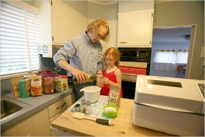 Kelly Oram and his daughter Micaela make gluten-free bread at home. Mr. Oram suffered for years from celiac disease before a doctor thought to test him for it.